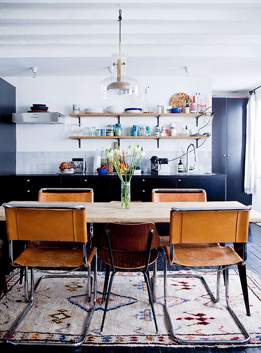 wood table with leather dining chairs in bohemian modern kitchen photographed by julie ansiau. / sfgirlbybay