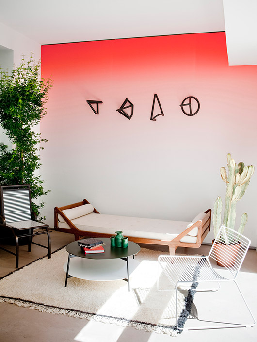 modern room with red ombre wall paint and wood daybed and mismatched chairs photographed by julie ansiau. / sfgirlbybay