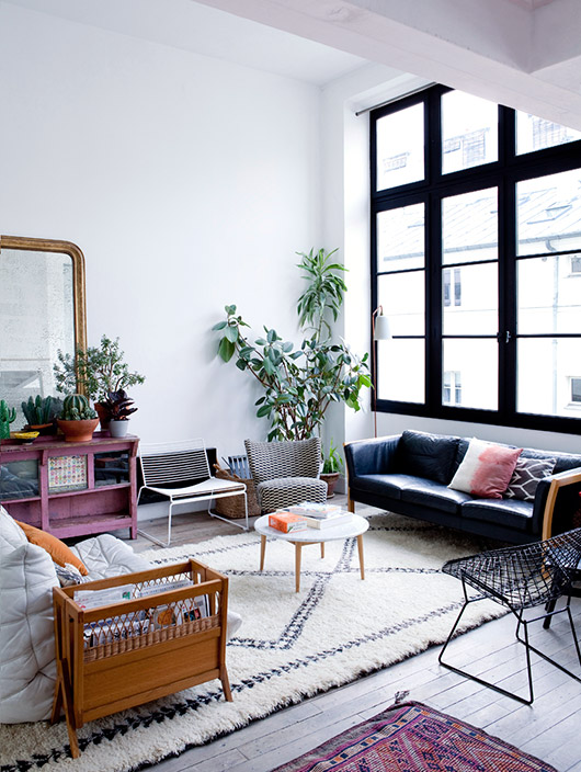 modern living room with tall ceilings and black framed grid windows photographed by julie ansiau. / sfgirlbybay
