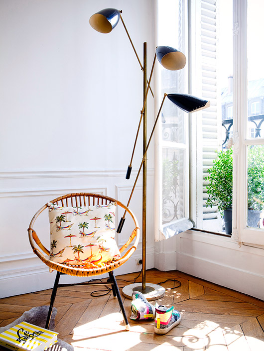 rattan acapulco chair next door a vintage floor lamp photographed by julie ansiau. / sfgirlbybay