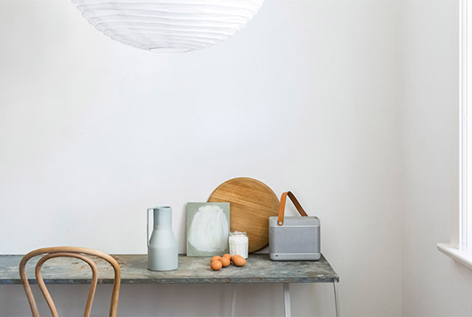 pastel kitchenwares with eggs on a sleek table with white paper lantern hung above / sfgirlbybay
