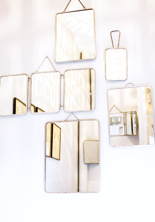 vintage mirrors with silver frames and little hangers, via inside closet. / sfgirlbybay