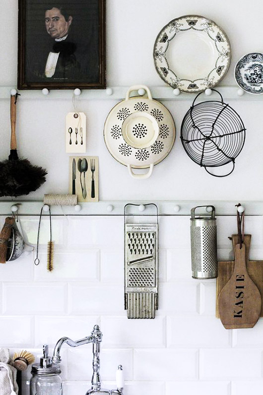 kitchen tools and and a vintage portrait on white pegs / sfgirlbybay