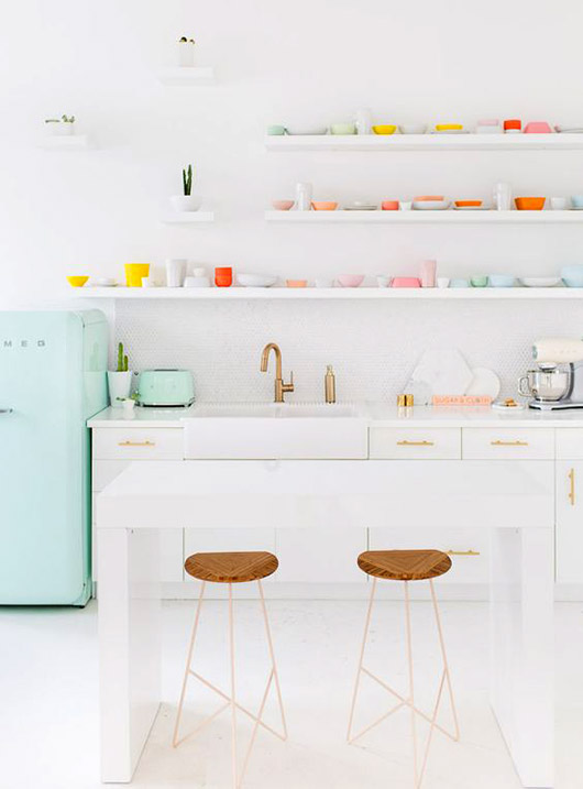 white kitchen with mint green smeg refrigerator and colroful dishware on open shelves / sfgirlbybay