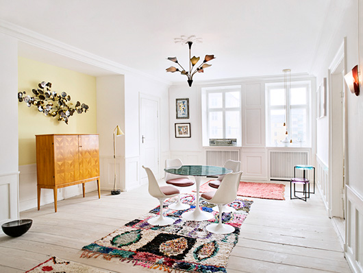 moroccan area rug on painted white floors in the apartment denmark / sfgirlbybay