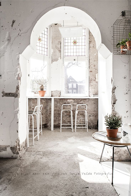 mediterranean concrete space with stained glass windows / sfgirlbybay