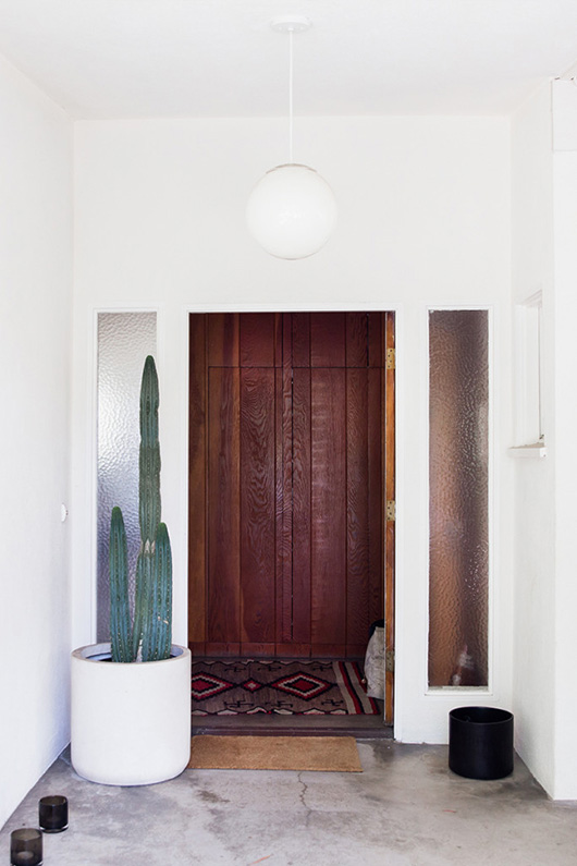 modern exterior entrance with potted cacti and globe light fixure / sfgirlbybay