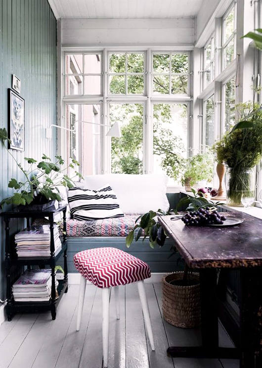 cottage sun room with colorful textiles / sfgirlbybay