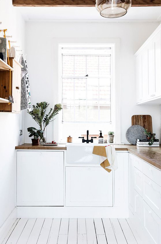 small, white kitchen with wood countertops / sfgirlbybay