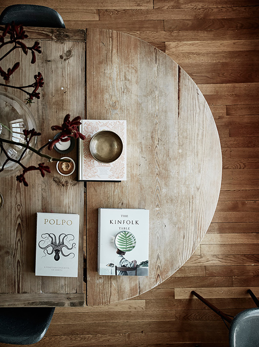 books on a round wood table / sfgirlbybay