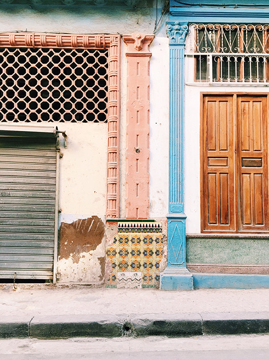 colorful painted buildings in cuba. / sfgirlbybay