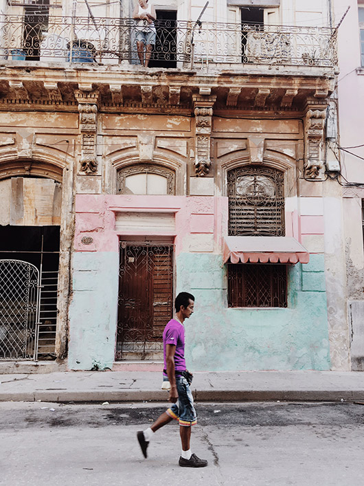 man walking in front of cuban architecture. / sfgirlbybay