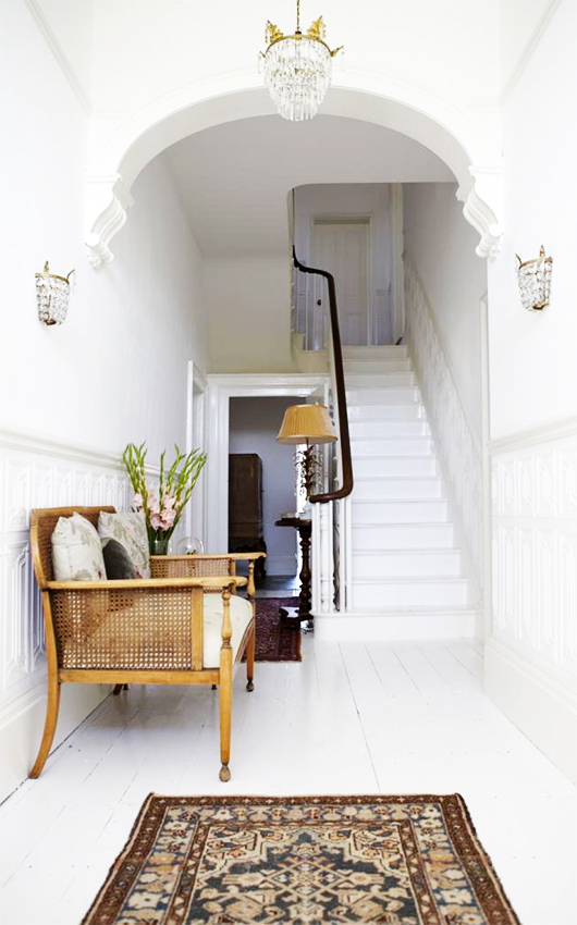settee in hallway with painted white floors / sfgirlbybay