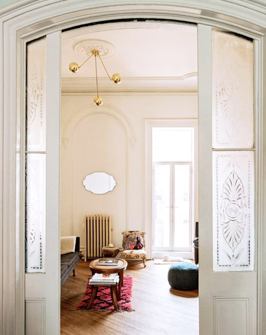 arched set of pocket doors in living room. / sfgirlbybay