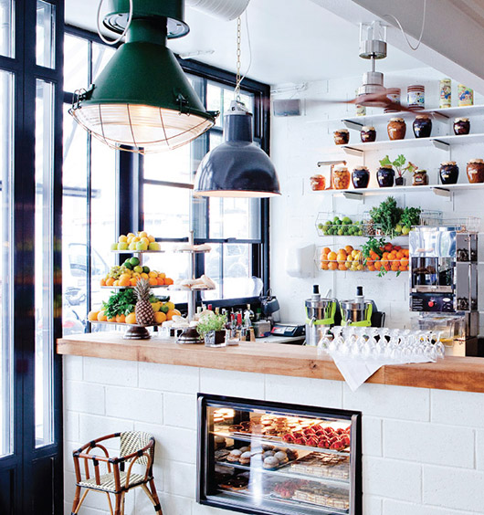 industrial lighting and butcher block counter at brasserie barbès. / sfgirlbybay