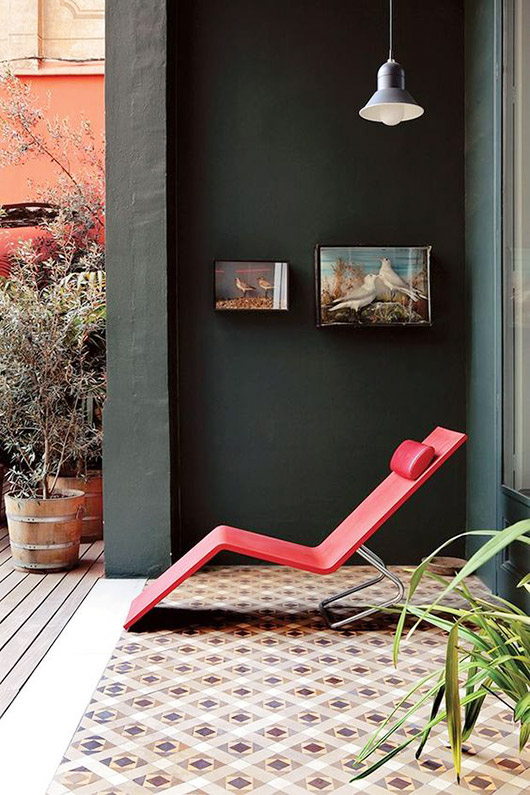 modern red chaise lounge on tiled patio. / sfgirlbybay