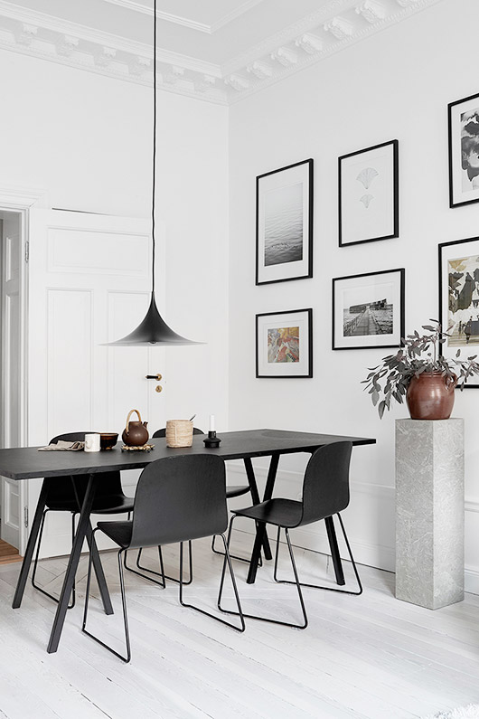 black dining table and pendant lamp with art gallery wall. / sfgirlbybay