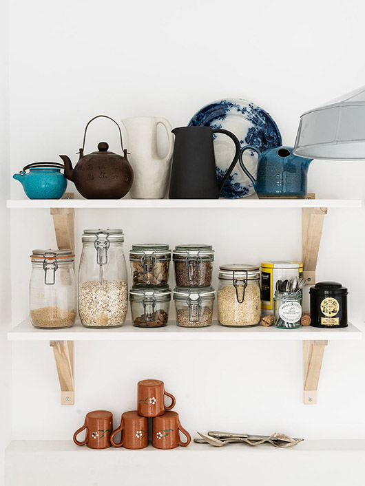jars and kitchen wares on open shelves. / sfgirlbybay