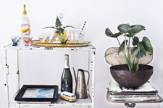 rustic bar cart and potted plant. / sfgirlbybay