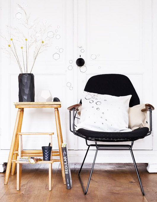 vintage black chair with stool and vase. / sfgirlbybay