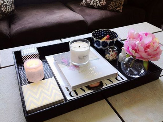 coffee table with tray of books and decor. / sfgirlbybay