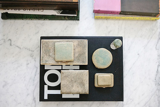coffee table styled with metallic accessories. / sfgirlbybay