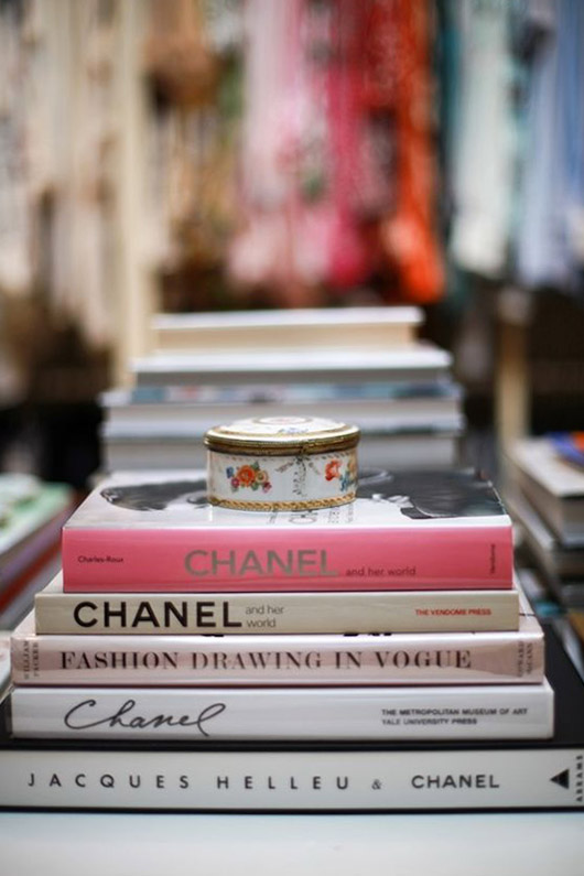 stack of fashion books with porcelain box on top. / sfgirlbybay