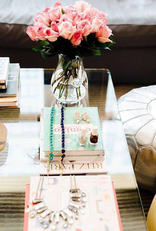 glass coffee table styled with accessories and decor. / sfgirlbybay
