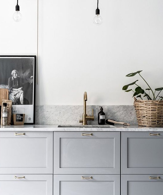 gray cabinets with marble countertops. / sfgirlbybay