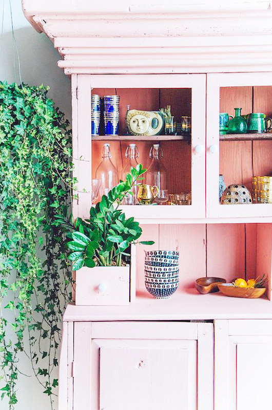 painted pink cabinet with green plants. / sfgirlbybay