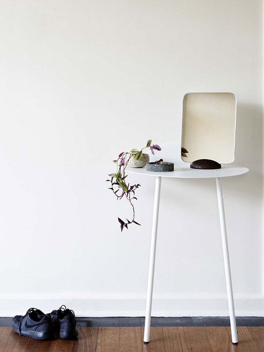 white entryway with white table and minimalist mirror. / sfgirlbybay