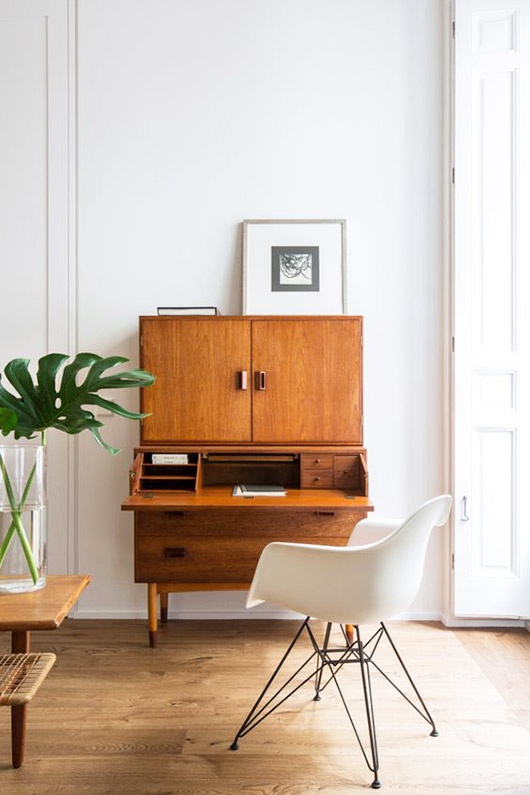 wood cabinet with fold-down desk and modern chair. / sfgirlbybay