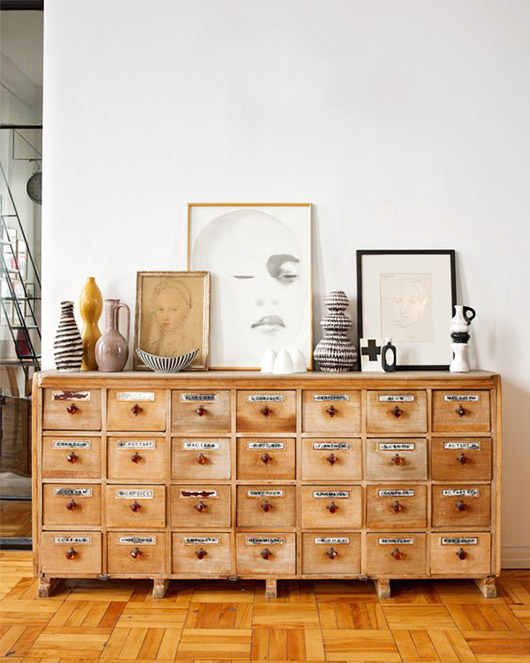 wood card file cabinet with framed portraits. / sfgirlbybay