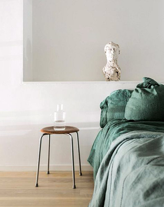 green bed linens. / sfgirlbybay