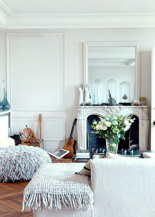 vintage fireplace with oversized white mirror and decor. / sfgirlbybay