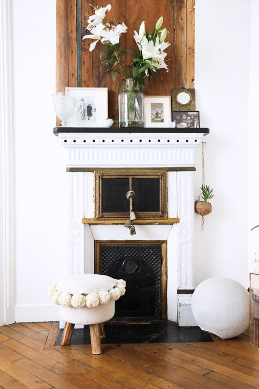 spring decor on mantle with rustic wood backsplash. / sfgirlbybay