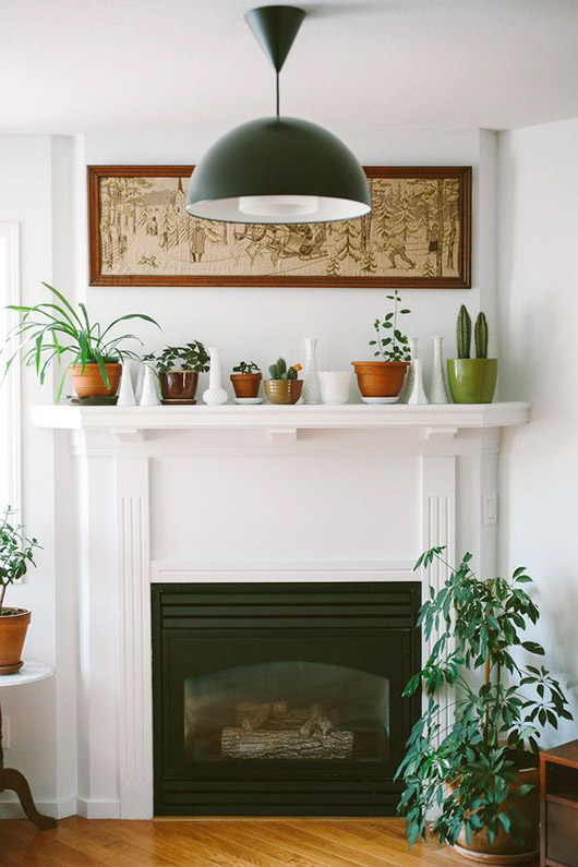 simple plants and vases on white mantel above fireplace. / sfgirlbybay