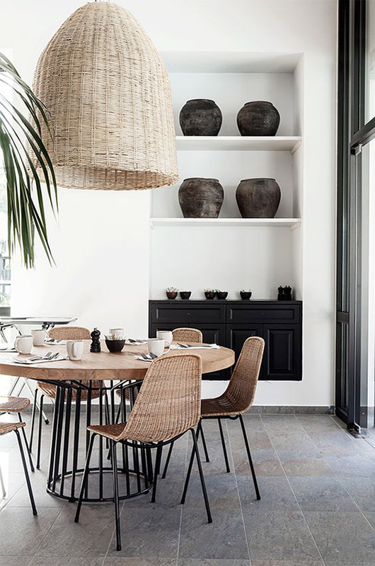 woven pendant lamp over dining table with rattan chairs. / sfgirlbybay