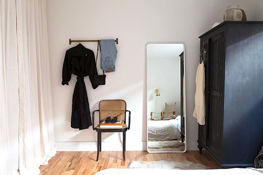 black wardrobe cabinet and white framed mirror. / sfgirlbybay