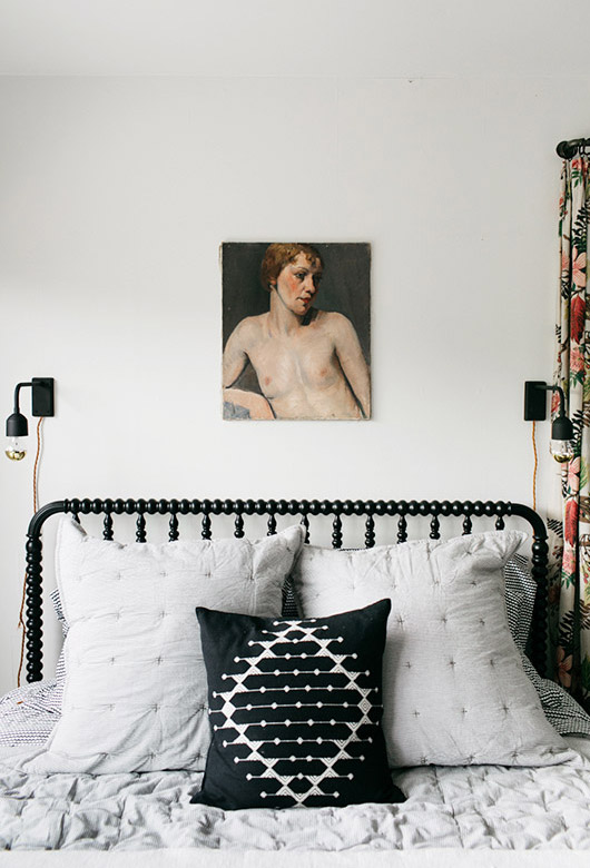 nude portait painting hung over guest bed. / sfgirlbybay