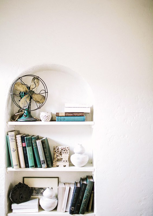 vintage fan and books on built-in shelves. / sfgirlbybay