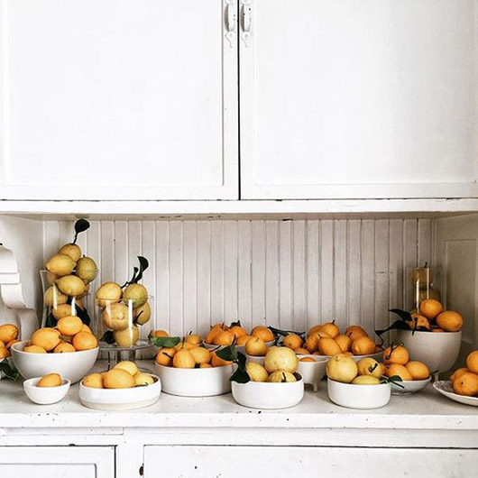 countertop filled with lemons in white ceramic bowls. / sfgirlbybay
