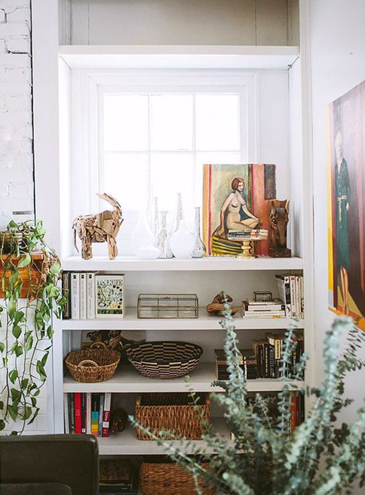 curated collection on white built-in shelving unit. / sfgirlbybay