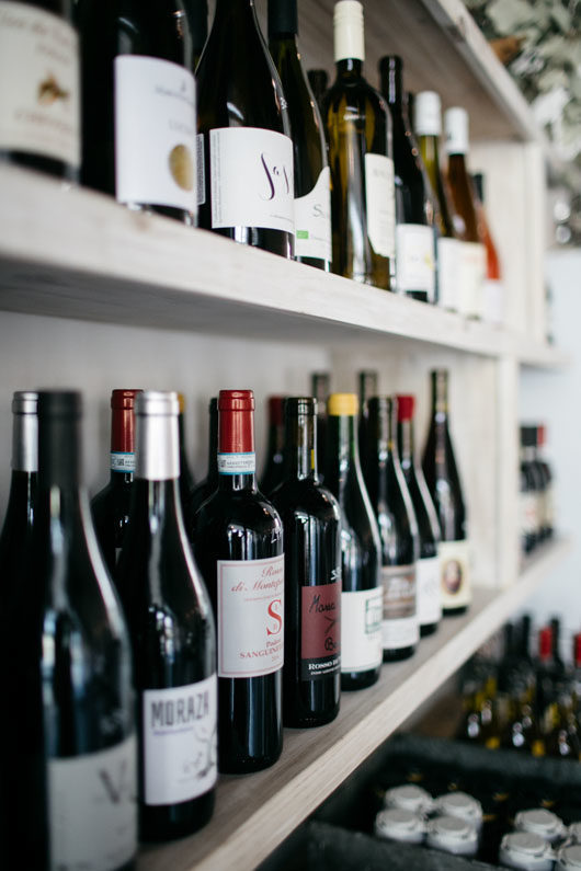 wine on open shelves at botanica in L.A. / sfgirlbybay