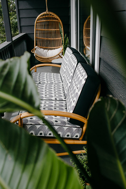 "hable construction ""rise"" print upholstered patio sofa and bamboo hanging chair. / sfgirlbybay"