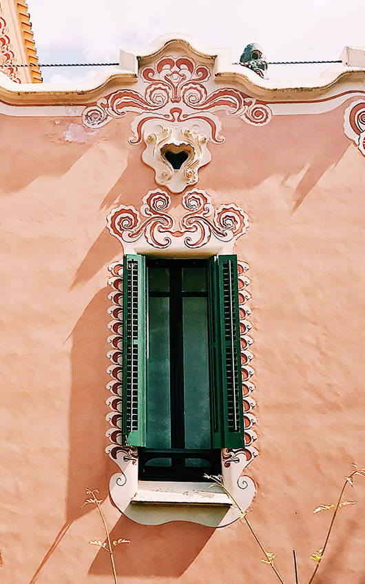 pink building with green shutters spain. / sfgirlbybay