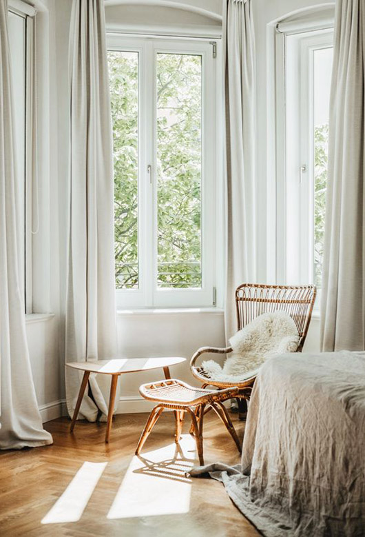 light and sunny room with bamboo chair and foot stool. / sfgirlbybay