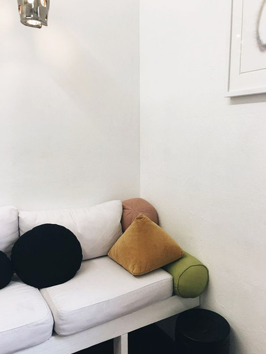 colorful pillows in various shapes on white sofa. / sfgirlbybay