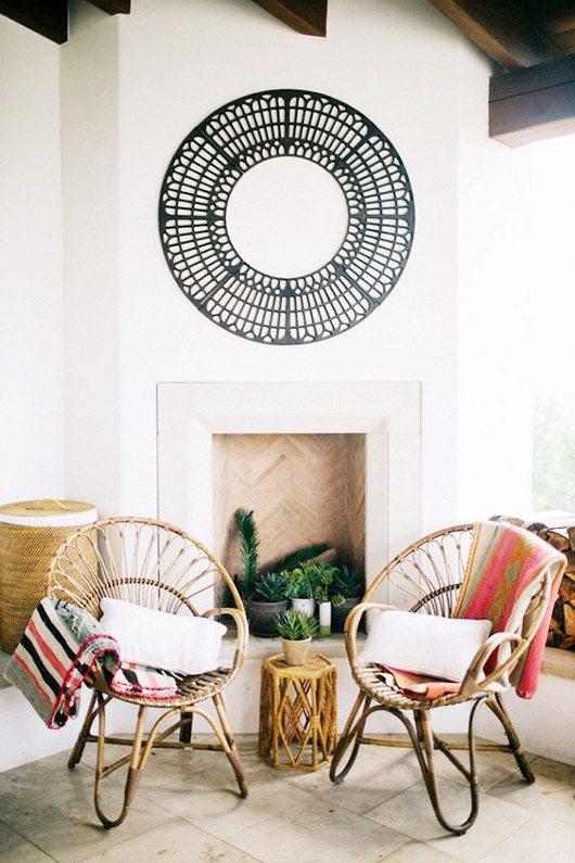 matching rattan chairs with throw pillows and blankets. / sfgirlbybay