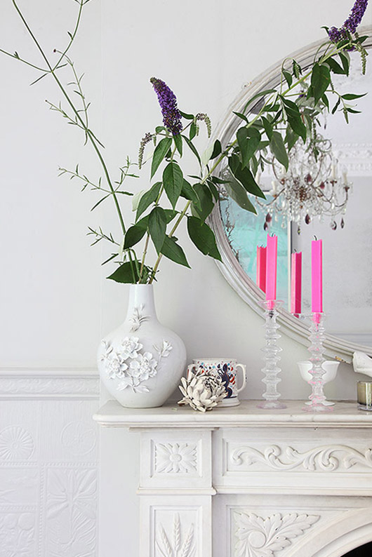 branches and flowers in white vase on white mantel. / sfgirlbybay
